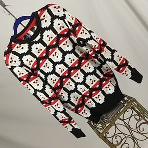 Divided pixelated Santa sweater